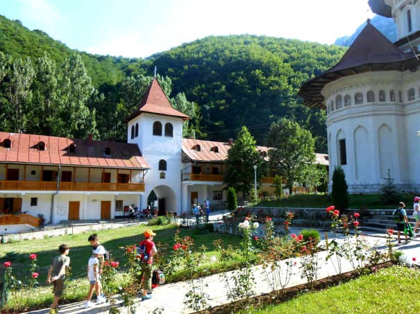 Monastery in Romania with children exploring